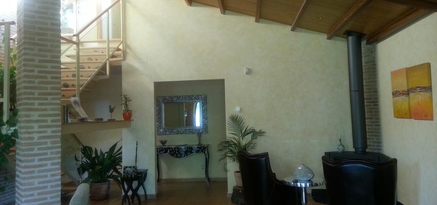 Recibidor, Salon, Escalera Estilo contemporaneo Color marron, amarillo, marron  diseñado por Arquigestiona   Arquitecto Técnico
