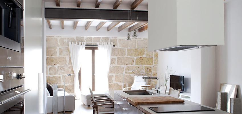 Sala de la TV, Cocina, Salon Estilo contemporaneo Color marron, marron, blanco, negro, plateado  diseñado por Cotacero Taller Arquitectura | Arquitecto